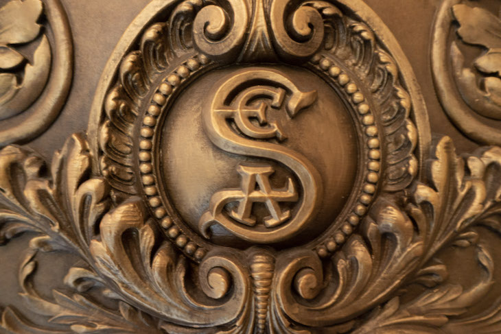 The SEA logo on the entrance door to Magellan's Restuarant